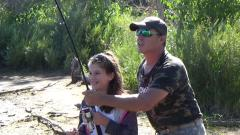 James helps his daughter battle her first big carp
